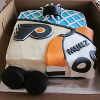 Flyers Hockey Cake Bday cake for my nephew, a huge flyers fan. Choc. cake W/ marshmallow frosting. The pucks are Ring Dings covered in black fondant.