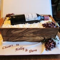 Wine Bottle Cake Wine bottle cake for a bridal shower. Dried panel crate, edible image label, RKT bottle covered in fondant, white chocolate shavings,...
