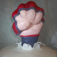 Mma Fist MMA fist is made from r.c. treats and chocolate cake with ganache and homemade fondant