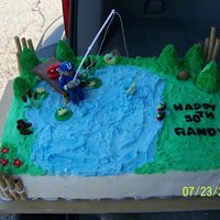 Fishing Cake And Cupcakes fondant figures and buttercream half white cake half chocolate cake