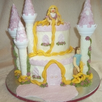 Rapunzel Castle Cake Homemade mmf with homemade modeling chocolate and chocolate cake filled with ganache and buttercream frosting.