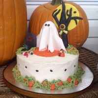 Trick Or Treat red velvet with crusting cream cheese frosting and fondant accents