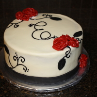Monogram With Roses This was a surprise birthday cake for a girl turning 30. It is a red velvet cake with cream cheese frosting (Crusting cream cheese recipe...