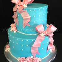 This Baby Shower Cake Was Based Off Of The Colors Of The Couples Nursery Decor Pink And Turquoise Iced In Buttercream With Fondant Bows This baby shower cake was based off of the colors of the couples' nursery decor - pink and turquoise. Iced in buttercream with fondant...