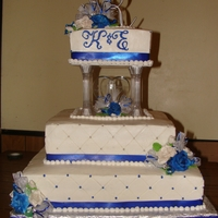 "Blue & White Square K&e Wedding Cake 16"" 14"" & 8"" tiers. Butter cream, gum paste roses, blue satin ribbon, quilted, silver dragees,"