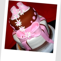 Pink And Brown Baby Shower Cake Made this for a friends daughter in law, top is red velvet with crm cheese frosting and bottom is white and chocolate with buttercream. All...
