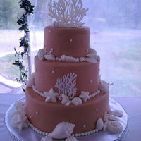 Wedding Shells Buttercream with white chocolate shells/coral and marshmallow fondant pearls.