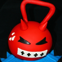 Kettle Ball Birthday Cake Chocolate Cake with Cream Cheese Frosting covered and detailed with Fondant