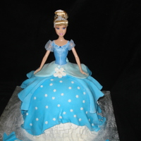"Cinderella Doll Cake This cake was made by using a stainless steel bowl as the mold and then an 8"" round cake pan. I wrapped the dolls legs and lower body..."