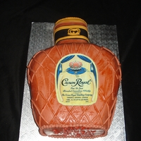 Crown Royal Bottle Bottle of Crown Royal. Covered in fondant with an edible image for the label.