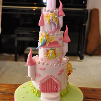 Pink Fairy Castle Madeira cake with vanilla buttercream and fondant. Based on a Debbie Brown cake. Delivering this 30 miles away was a bit on the stressful...