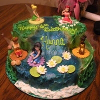 Tinker Bell And Friends I made the Water lilies out of gum paste and airbrushed the scenery.