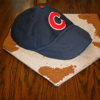 Cub's Hat Cake This was a groom's cake! It was chocolate with peanut butter buttercream under that fondant!