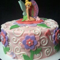 Tinkerbell My inspiration for this cake came from the bottom tier of aggiecakes' adorable Tinkerbell cake. Check hers out! =)