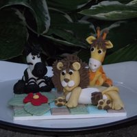Safari Animals I made this cake topper for my a friend of my daughter's baby shower. The figures are made of fondant mixed with tylose. Thanks for...