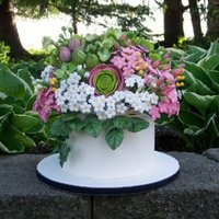 Hydrangeas, Ranunculus, Flower Topper In Gumpaste. Gumpaste flower topper of hydrangeas, ranunculus, filler flowers, buds, and leaves on a fondant covered Styrofoam tier. Thanks for looking...