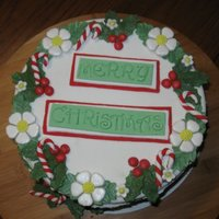 Merry Christmas Cake Vanilla cake with fudge filling and buttercream frosting. Decorations are fondant.