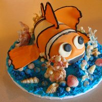 "Nemo Underwater   All decorations are made from chocolate,except on Nemo himself. I used sugar paste.Nemo sits atop a 12"" chocolate pillow cake."