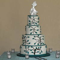 4 Tier Wedding Cake Marbled cake filled with ganche and covered in semi-sweet ganache and MMF