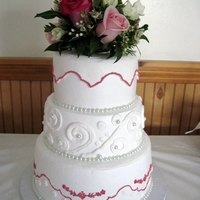 "White And Fushia Wedding Cake With Pearls 6"", 8"",10"" dbl lyr Chocolate Cake with Chocolate Whipped Filling. All covered in Whipped Frosting. Pearls are glass beads."