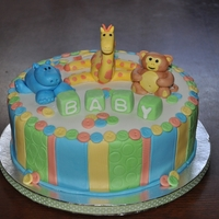 Baby Shower Zoo Theme Zoo themed baby shower with fondant animals and accents.