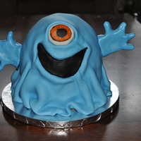 "Monsters Vs Aliens Bob Cake Blue Bob cake made for a little boys birthday. Made with 6"" rounds and 1/2 ball cake pans. Covered in blue marshmallow fondant."