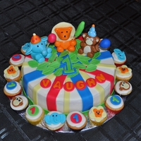 Circus Animal Theme Birthday Cake Animal Theme birthday with matching mini cupcakes. Buttercream icing with fondant accents and characters.