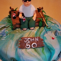 Fishin At The Cottage   Sponge cake covered in fondant, figure and fish etc all made in fondant