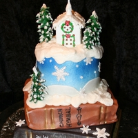 Christmas Birthday Cake Almond vanilla and chocolate cake with buttercream and fondant/gumpaste accents. The bottom tiers were two 8 inch square cakes iced in...