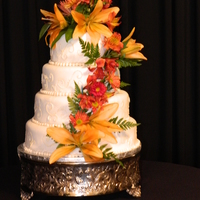 Fall Wedding Cake Round cakes covered with white fondant and Ivory scrolls.