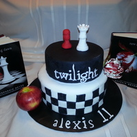 Twilight Cake Poundcake covered in fondant . Chess pieces and flower weremade with gumpaste