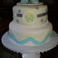 Monogram Baby Shower Lemon and chocolate cakes decorated with white vanilla fondant with turquoise, light yellow and light gray accents. Baby's initial and...