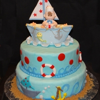 Sailor Baby Shower Maritime theme baby shower cake. Topper is made of cold porcelain. Cakes are decorated with fondant and accents are waves made with cricut...
