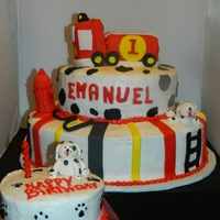 Firemen Theme Birthday Pound cake decorated in buttercream and fondant accents, Water hydrant and puppies made with gumpaste.