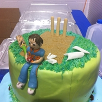Cricket Birthday Cake  Made this cake for a little guy who loves playing cricket.My first ever fondant covered cake.figures are fondant.Used light brown sugar for...