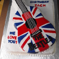 Beatles Guitar Cake Made for my nephew, a HUGE Beatles fan and a guitar-player. All buttercream with fondant accents