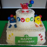 Baby's First Sesame Street Cake Baby Big Bird, Cookie Monster & Elmo on top made from fondant.