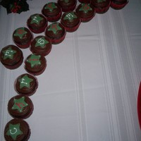 Christmas Cupcakes merry christmas! ghiradelli chocolate chocloate chip cupcakes with homemade chocolate frosting. fondant stars. buttercream letters. for my...