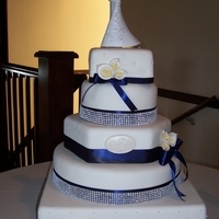Navy And White Wedding Mixed shape cake based on a pinkcakebox cake chosen by the bride. Base cake is a dummy for height, gumpaste callas. TFL!
