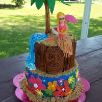 Tiki Luau Birthday made for my daughters 6th birthday. The bottom tier was to match her plates and the tiki was to match decorations. She wanted herself on...