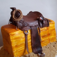 Cowgirl Birthday Modeling chocolate covered saddle, and fondant covered hay bale. TFL!