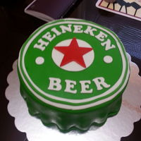 Heineken Cap Cake thanks to smash cakery for the help to do the cake ,this is 9 inch cake with buttercream and cover in marshmallow fondant and coconut...