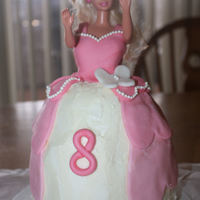 First Barbie Cake I made this for a friend as a practice cake. I did kind of the ombre look and then marbled the colors together to do the bodice. As a frist...
