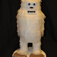 Yeti   Rice paper on buttercream. Feet and legs are crispy rice treats covered in buttercream then rice paper.