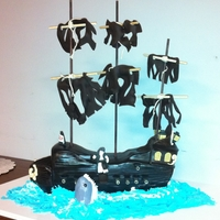 The Black Pearl Vanilla Cake with basic Butter Cream Filling. Masts are dowels, sails gumpaste. Front point of ship and shark made of Rice Krispies. Very...