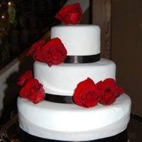Red Rose Wedding Cake Chocolate/White marble Cake, with simple real red roses and black ribbon. When we took the cake to the chapel, the florist never showed up...