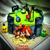 Angry Birds Buttercream cake with fondant accents. Castle walls are RKT covered in fondant.