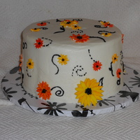 Yellow And Orange Daisies I did this for my soon to be sister-in-law's bridal shower. Pumpkin spice cake with cream cheese icing and gumpaste flowers.