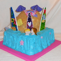 Hawaiian Island I did this cake for a friend's niece. White almond with cream cheese icing and fondant details.