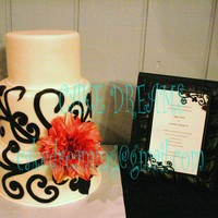 Scrolls To Match The Invitation 3 tiers covered in fondant with hand cut gumpaste accents to match the invitation.
